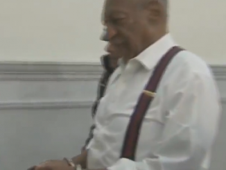 Bill Cosby in cuffs