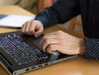 Male at laptop