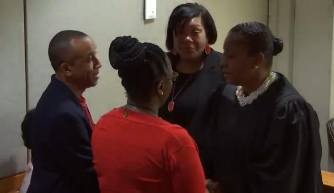 Judge Kemp speaks to Botham Jean's family members