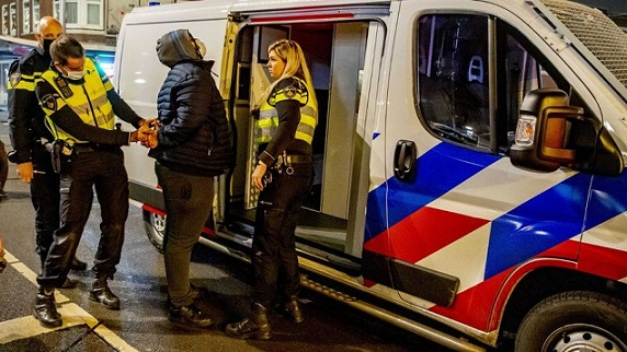 Netherlands arrests of rioters defying curfew