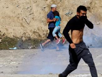 migrants storm US border