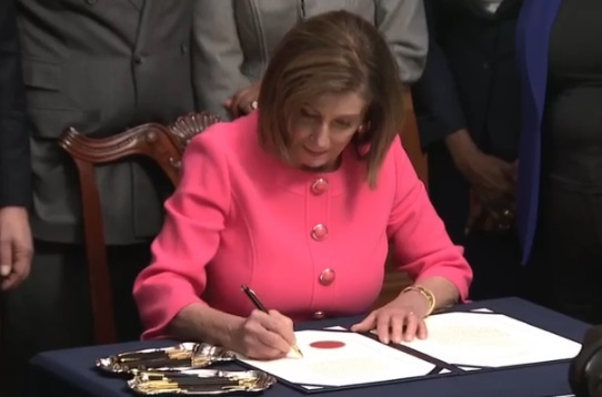 Nancy Pelosi signing articles of impeachment